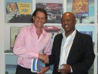 Greg Benatar of Alliance Media with Sam Mwai, CEO of the SSMB.