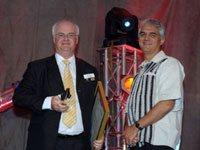 Bruce Cameron receives the Mondi Shanduka SA Journalist of the Year Award from Prof Guy Berger