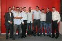 Lucas Radebe Soccer Finanace and Penquin management teams. Left to right: Glyn Binkin; Darren Leishman; Clive Lawrence; Grant Leishman; Mike Bray; Lucas Radebe; Greg Kockott; Allan Nossel; Warren Lewis; Gary Blumberg.