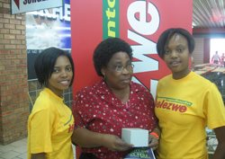 Pictured in the centre is Sbongile Sibiya who was the winner at the promotion at the Spar in Mtubatuba with promoters Stho and Leigh Mbuli.