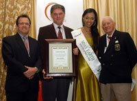 Johan Joubert, second from left, accepts the Nick Steele Memorial Award for Environmentalist of the Year on behalf of Adrian Gardiner, owner of Shamwari Game Reserve in the Eastern Cape. With him is Steve Bluen (SAB director for corporate affairs and HR), Miss Earth South Africa 2008 Matapa Maila and judge Dr Ian Player. Picture by Lettie Ferreira.