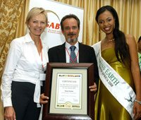 Tony Carnie of The Mercury receives a merit award in the SAB Environmental Journalist print & Internet category. With him is Janine van Stolk (SAB communications manager) and Miss Earth South Africa 2008 Matapa Maila. Picture by Lettie Ferreira.