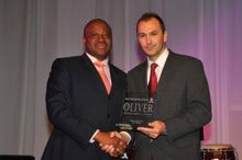 Winner of the Most Improved Year-On-Year BEE Score card – IBurst. Thami Mtshali, Founder of IBurst with Stephen Paxton from Impumelelo.