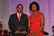 Winner of the Top Empowered National or Regional Transforming Government Department – The Department of Defence. Judy Chileshe, Sales Manager of Topco's Top Women in Business and Government publication with the representative from the Department of Defence.