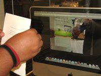 Visitor's displayed a leaflet in front of a Mac Powerbook's webcam to activate a 3D animation aerial combat scene that was superimposed on the live webcam feed.
