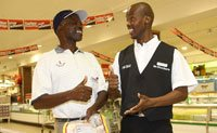 Deaf staff member Vincent Masilo assisting shopper Gidion Tsindi at Checkers Hyper at Centurion.