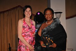 Ilse Pienaar, Publisher of Topco Media's publication, Top Women in Business and Government, presents the Top Businesswoman of the Year Award to Zanusi Brand Solution's CEO, Nomahlubi Simamane.