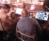 Two members of the Daily Dispatch Online team hard at work after the 2009 Vodacom Journalist of the Year Awards ceremony.