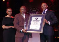 Khaba Mkhize (center) received the lifetime achievement award at the annual Vodacom Journalist of the Year Awards. He received the award from Romeo Kumalo (right), executive director: commercial (Vodacom SA) and judge Maud Motanyane (left).