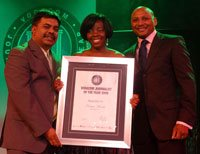 Nomsa Maseko was named the 2009 Vodacom Journalist of the Year winner and received R125&nbdsp;000 for Xenophobia in Gauteng on Talk Radio 702's Eyewitness News With her is judge Robin Sewlal, left, and Romeo Kumalo, right, executive director: commercial (Vodacom SA).