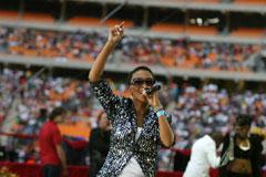 Nhlanhla Nciza from Mafikizolo, wearing her signature glasses, entertains the crowd