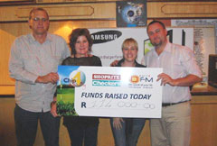 A whopping R114 000 was raised at this year's Shoprite Checkers OFM Chip for Charity. Here Mr. Gary Stroebel from OFM and Mr. Jaco de Swardt from Shoprite Checkers handover the cheque to Ms. Rietha Wagenaar from Child Welfare Bloemfontein & Childline Free State and Ms. Michelle Gertz from the Smile Foundation.