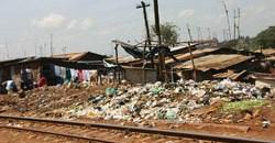 Trash by the railroad tracks. Kibera. (Image: Arria Belli, via Wikimedia Commons)