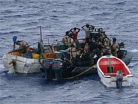 Suspected Somali pirates are apprehended by a patrol of the European Union Naval Force Somalia (EUNAVFOR), one of several initiatives to combat piracy against international shipping off the coast of Somalia. Source: EUNAVFOR