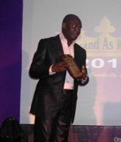 Dan Oshodin, CEO of TMKG, recieving the award