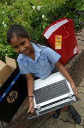 Dhiya Rangasamy with the new laptop that she will use for writing her speeches