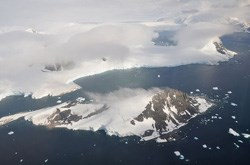 This picture is from the SW Antarctic Peninsula region. It's an aerial view from a position over Laubeuf Fjord, looking to the NW. In the foreground is Webb Island with its summit of 398m. Behind it is a part of the Wright Peninsula on Adelaide Island's east coast. (Image: Vincent van Zeijst, via Wikimedia Commons)