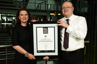 Richard Stewart, MD Millward Brown South Africa, handing an award to Jen Roberti, Group Executive, Group Marketing for MTN for being the first African brand to make it on the rankings