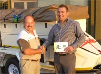 Andre de Villiers, managing director of Safari Centre 4x4 stores and Johan Bekker the winner of the Jurgens XT140 Trailer