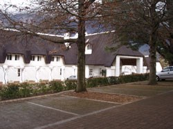 """The thatched roof gives Le Franschhoek Hotel & Spa an inviting """"cottagey"""" look."""