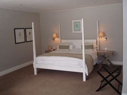 The bedroom - and the bedpost (left) that caused all the trouble.