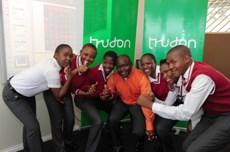Kwena Molapo High School Principal Michael Maligana and young students