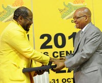 President Jacob Zuma receiving the Census 2011 report from Statistician General Pali Lehohla.