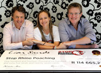 (L-R) Brothers Nicholas More (CEO Lion Sands) and Robert More (CEO More Collection) flank Elise Daffue, founder of the Stop Rhino Poaching campaign. Photo by Lettie Ferreira.