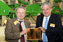 Minister of Department of Trade and Industry, Dr Rob Davies, and Se Higgins, co-founder of Kuvusa Mills, celebrate the opening of the first small-scale maize milling plant in Durban.