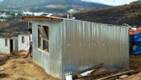 The iShack offers a potential solution to South Africa's housing delivery backlog, increasing urbanisation and the growing number of informal settlements in the country. The high-tech shack was developed to provide township communities with a reliable source of electricity and protection from extreme temperatures.