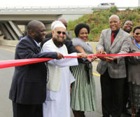 Gauteng's MEC of transport Ismail Vadi (second from left) and Sindisiwe Chikunga, the deputy minister of transport (third from left), assist Transport Minister Ben Martins in cutting the ribbon to officially reopen the Misgund interchange. (Image: )