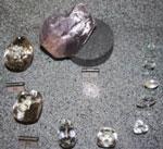 A replica Cullinan Diamond, with the nine stones it was cut into.