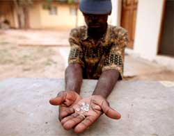 An illegal diamond dealer in Zimbabwe holds gems from Marange mine. Zimbabwe has stopped illegal mining and is now selling its diamonds in Antwerp. Image: