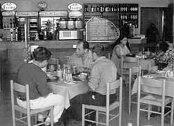The original Ocean Basket in Menlyn with Fats and George Lazarides having a bite. Image: