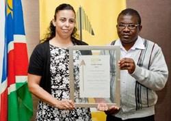 Heidi Fernandes and Isaac Mangochi accepting the award on behalf of Alliance Media