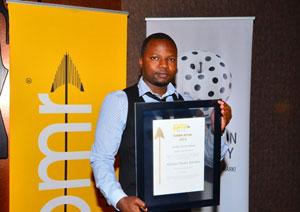 Sekani Nkhata receives the PMR award on behalf of Alliance Media