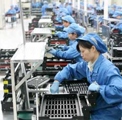 Workers at Foxconn's Taipei factory have helped boost Taiwan's exports by 10.6% as markets in the USA and Europe recover and demand for electronic products rises sharply. Image: