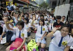 """Thousands of students protesting in Hong Kong were tear-gassed by police last week. Then hacking group Anonymous threatened to sabotage """"all government websites"""" and now five hackers have been arrested and detained. Image:"""