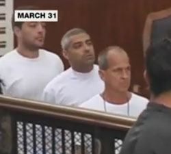 The three defendants pictured here during their trial; the trial and its outcome have been slammed as a sham by the international community and media. (Image: Extracted from YouTube)
