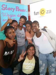 False Bay TVET College students with Zimkhitha (FunDza) at the Nali'bali/FunDza stand during the College's Orientation.