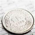 Nestlé first half profit slips on strong Swiss franc