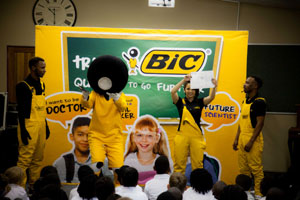 BIC Boy brand mascot with a BIC brand ambassador from Zinto addressing pupils on the importance of education.