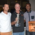 Winners Blair Taberer (left) and Munya Mudyanadzo (right) being presented with their trophy by AAT group chairman Dave Glynn(middle)