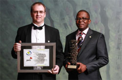 Frans Menz receiving Lomati Sawmill's award on behalf of General Manager Tewie Giliomee.