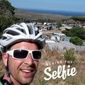 I love my tech, but love a ride around the Peninsula even more! Here I am on top of Red Hill with a characteristic SA background: a township that plays gospel music every time I pass on Sunday morning and the blue, bone-chillingly cold ocean in the back! Hope to see you on the road – but when in a car: Stay wider of the (bicycle) rider!