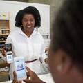 Ruth Mafupa accepts payments on the iKhokha device.