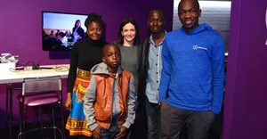 Sheryl Sandberg with young Malawian developers