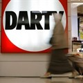 People walk past the logo of electrical goods retailer Darty shop in La Defense near Paris, France, last week. Image credit:
