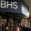 Pedestrians walk past the entrance to a BHS store on Oxford Street in central London on 25 April 2016.