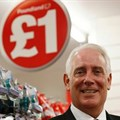Outgoing Poundland CEO Jim McCarthy poses for a photograph in a store in London, the UK.